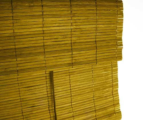prachtige bamboe vouwgordijnen die subtiel opgevouwen kunnen worden